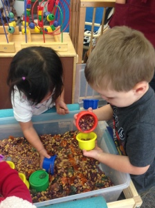 More fun with our sensory bin... our friends are hard at work!